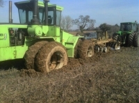 We have for the first time in 24 years managed to get one of our steiger tractor's stuck, As you can see the field is laying a bit wet still. The John deere 8200 came to the rescue and pulled it out, Hopefully before to many people noticed, As it was right by the road.